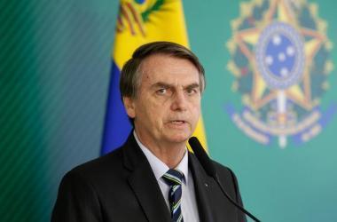 Bolsonaro posa ao lado de sua equipe ministerial no evento que celebrou 100 dias de Governo, em Brasília, na última quinta-feira. ADRIANO MACHADO REUTERS